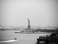 [2005] A Boat to Liberty (Diego3336) Tags: nyc newyorkcity winter bw sculpture usa snow newyork cold ice monument statue ferry america port river liberty island harbor boat newjersey waves crane nj landmark cranes statueofliberty icy seaport libertyisland ladyliberty newyorkharbor libertystatue libertyenlighteningtheworld lalibertééclairantlemonde