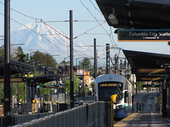 A train leaves the Columbia City station while Mount Rainier dazzles in the background. Photo by Wendi.