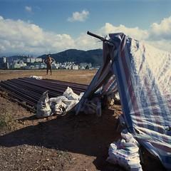 . (GraemeNicol) Tags: china house home construction asia scaffolding homeless tent structure shenzhen suburbs shelter development embankment earthwork migrantworker gncn2009