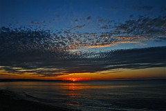 The Sun at a distance..... (ineedathis, Everyday I get up, it's a great day!) Tags: blue sunset sea sky sun newyork reflection beach clouds nikon longisland d80 crabmeadow