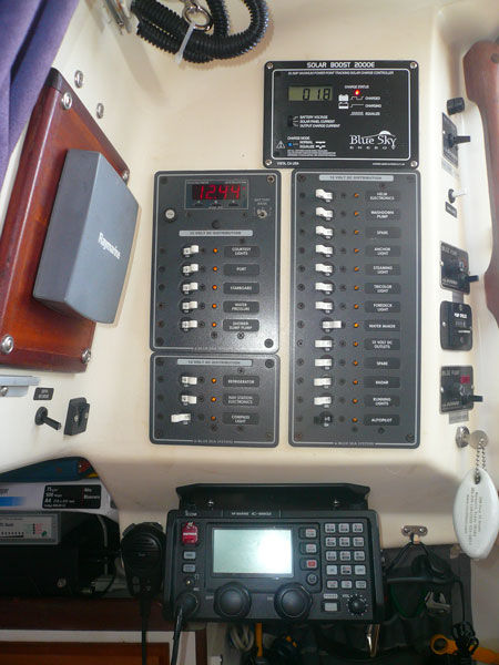 a shot looking straight aft at the DC electrical panels, bilge control area, SSB, and up on the left is the inside depth sounder