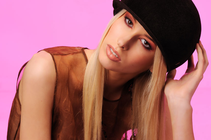Colour Hats & Beauty in The Studio, Black Hat Pink Background