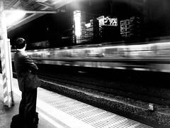 88/365: Transit (joyjwaller) Tags: blackandwhite man motion japan night train hope tokyo waiting shinjuku trainstation transit commute salaryman repression japaneseman project365