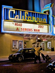 A Serious Man (Chris Saulit) Tags: california road cinema man classic sign night vintage movie marquee berkeley theater neon theatre signage minicooper boxes cart dolly 2012 theroad kittredge aseriousman