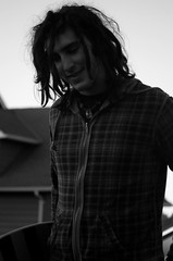 Jordan (Crystal-Rose Mihaylo) Tags: portrait bw dreadlocks evening blackwhite smirk dreads longboarding