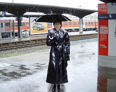 On the station (mallorcarain) Tags: fetish nice boots vinyl streetshots raincoat pvc bottes fakes stiefel raincape regenmantel cir lackmantel impermables