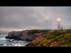 Yaquina Head Lighthouse - HDR (David Gn Photography) Tags: sea fog oregon lighthouses pacificocean newport oregoncoast beacon hdr yaquinaheadlighthouse photomatix interestingness361 oregonstallestlighthouse canonpowershotsx1is explore27jul09