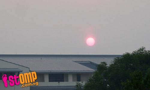 Sun turns red under effects of the haze