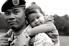 A hero is an ordinary individual who finds the strength to persevere and endure in spite of overwhelming obstacles. (Kelly West Mars) Tags: family portrait blackandwhite baby love soldier army 50mm toddler unifor