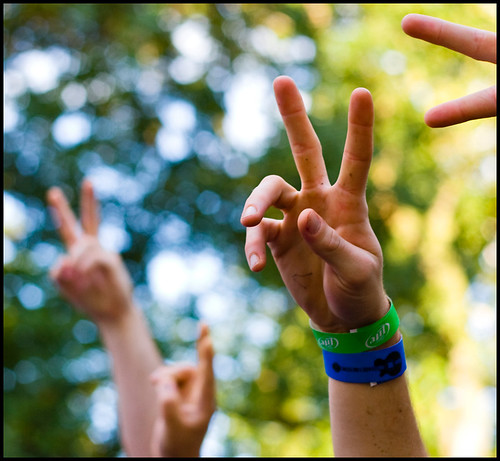 Festivalgoers form peace signs with their hands in Peace Park while listening to the Itals performance on Saturday, Sept. 26, 2009. The Itals, a reggae group hailing from Jamaica, asked the crowd, Give us some peace!