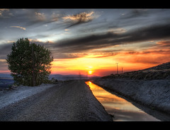 Against the Approaching Curve (Philerooski) Tags: road sunset sky sun color reflection tree art water beautiful clouds photoshop reflections painting canal washington amazing fantastic perfect rocks path telephone hill great pole stunning wa hdr highdynamicrange slope gravel tumbleweeds sagebrush refections gravelroad kennewick 3xp photomatix liquidsilver liquidgold thompsonhill telphonepoles