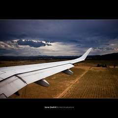 Into Canberra. ([ Kane ]) Tags: sky storm grass clouds plane wing threepeaks canberra kane act whitelion 3peaks gledhill 50d kanegledhill wwwhumanhabitscomau kanegledhillphotography