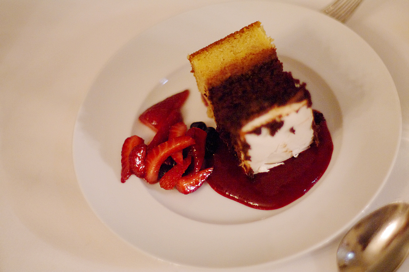 Wedding cake served with strawberries & coulis