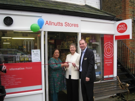 Shanhaz Javid, Janet Whitehouse and Jon Whitehouse celebrate the re-opening of Allnutts Post Office
