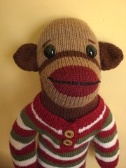 Slim the sock monkey in his Christmas jammies (No Knit Sherlock!) Tags: christmasdecorations sockmonkeys ravelry mrfoster knitpicksmrfostersockmonkey slimslongies