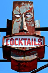 islander tiki sign (Dave van Hulsteyn) Tags: abandoned sign vintage steel neglected cocktail forgotten weathered rusting peelingpaint tiki decaying patina weatherbeaten