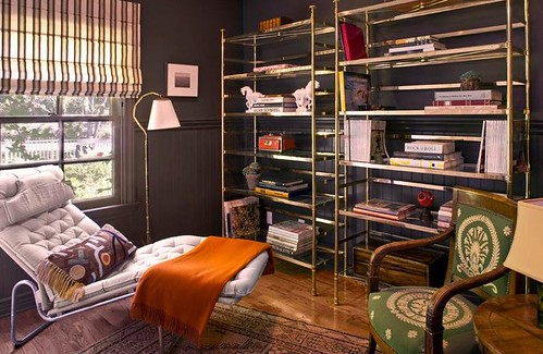 Dark + modern: Gray library + open shelves + orange throw
