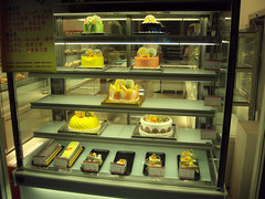 Desserts for sale in the window in Hangzhou, China at night