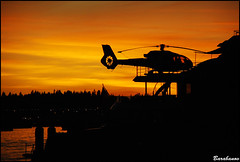 do you wanna take a ride? (Miss Barabanov) Tags: ocean sunset pordosol praia water silhouette gua ferry vancouver boats twilight downtown barcos helicopter lgb lionsgatebridge northvancouver helicptero oceano silhueta greatervancouver hileporto