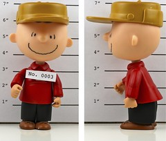 Wanted: Charlie Brown (kevin dooley) Tags: christmas xmas red brown holiday shirt happy character cartoon police peanuts charlie criminal cap snoopy mug mugshot chuck wanted charliebrown merry cb plaid lineup suspect charlesshultz