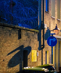 Amber / Blue 3 (stephenbryan825) Tags: liverpool barbedwire buildings hardlight harsh pub selects shadows sign