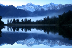 mts tasman and cook in lake matheson (go wild - NZ outside) Tags: park new blue lake reflection geotagged island dawn early mt box chocolate south cook zealand alpine national pre nz tasman aotearoa westland matheson excellence aoraki grandeur glaciation interest100 geo:lat=434377761762538 geo:lon=1699628734588623