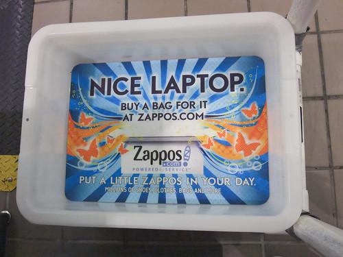 Zappos.com Ad in TSA Security Tray