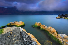 MAGICAL (tropicaLiving - Jessy Eykendorp) Tags: longexposure blue light sunset sky bali lake nature water clouds indonesia landscape rocks crater magical batur kintamani efs1022mm lakescape outdoorphotography canoneos50d bwcpl tropicaliving alemdagqualityonlyclub hoyandx400 hitechfilters vosplusbellesphotos saariysqualitypictures rawproccessedwithdigitalphotopro tiffproccessedwithadobephotoshopcs3
