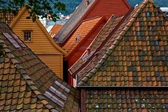 Rooftops of Bergen (Rozanne Hakala) Tags: wood norway architecture harbor norge rooftops landmark medieval historic unescoworldheritagesite unesco roofs german wharf shops bergen scandinavia middleages bryggen hordaland hanseatic thewharf hanseaticleague tyskebryggen backofbryggen