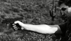 Desert Shooter #3 (Coswyn) Tags: arizona blackandwhite southwest phoenix 50mm nikon gun desert f14 14 pistol guns shooting shooter nikkor handgun sonorandesert 9mm firearm firearms d300 f14d 14d d300s gilladesert