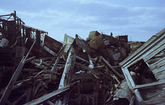 0004 1 (noise64) Tags: newyorkcity film graveyard 35mm photography boat nikon statenisland nikkor agfa filmscan nikomat agfavista