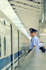 300-Series Shinkansen Dispatched to Nagoya: Tokyo Station, Japan (Alfie | Japanorama) Tags: portrait man hat station japan train photography japanese tokyo official nikon diptych uniform dof bokeh transport guard working platform rail railway depthoffield story worker teaching lesson publictransport shinkansen whistle eki hikari bullettrain d300 300series nikkor85mmf14afd dr6rightangleviewfinder