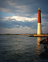 Barnegat Lighthouse (GGoddessS) Tags: ocean sunset sky lighthouse reflection beach water clouds ripples barnegat