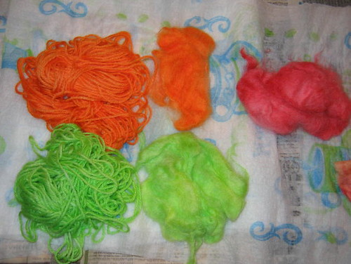 Brightly dyed wool roving and wool yarn