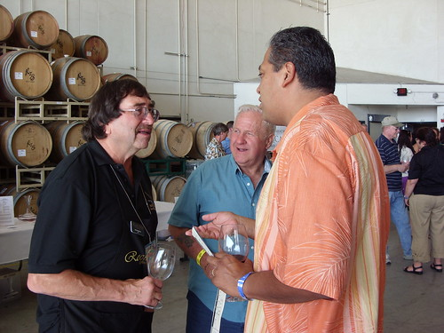 Ken Rosenblum and guests enjoy the second open house at Rock Wall Wine Company on September 26, 2009.