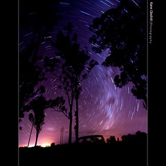 Space and Time ([ Kane ]) Tags: longexposure sky black tree night stars star exposure glow farm country australia explore ute kane cp frontpage 1020 celestial southpole startrail gledhill gatton 50d kanegledhill celestialpoint celestialpoles wwwhumanhabitscomau kanegledhillphotography week2ab