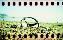 post-atomic scenery (P e T e r P a N) Tags: film beach wheel seaside lomo xpro lomography sand mare loneliness gulls apocalypse crossprocessing analogue negativo spiaggia gabbiani sabbia film35mm abbandono sprocketholes analogico desertion degrado fujisensia200 apocalisse kenilguerriero sterzo holgagcfn munnezz canoncanoscan8800f