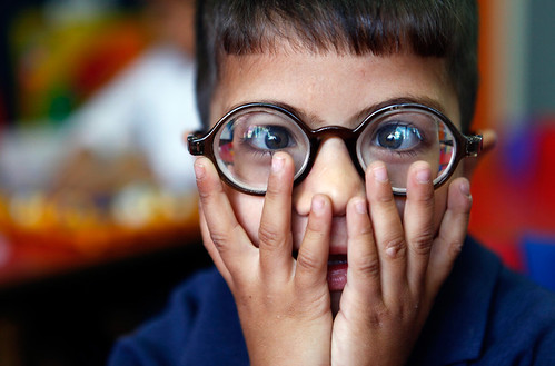 Daoud, a five-year-old visually impaired Palestinian boy, reacts to light after a teacher opened the window