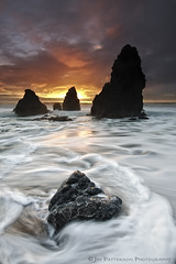 In The Moment #2 - Rodeo Beach, California (Jim Patterson Photography) Tags: ocean california sunset red sea portrait sky usa sun seascape motion color beach nature water vertical clouds landscape photography coast marine rocks colorful waves natural pacific tripod shoreline scenic rocky wideangle icon coastal shore lee vista marincounty sunburst coastline sausalito iconic gitzo marinheadlands seastack reallyrightstuff rodeobeach remoterelease nikkor1224mm goldengaterecreationarea graduatedneutraldensityfilter singhray nikond300 markinsm20ballhead jimpattersonphotography jimpattersonphotographycom seatosummitworkshops seatosummitworkshopscom
