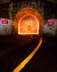 Steel Wool, The wrong way (dannotti) Tags: road longexposure bridge light signs lightpainting wool yellow night canon concrete washington mark stripe tunnel ii spinning 5d asphalt sparks wrongway steelwool 5dmarkii