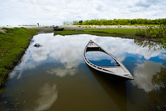 In the land of landscapes - XV (Catch the dream) Tags: sky reflection nature clouds landscape boat horizon calm submerged bangladesh immersed kuakata waterbody gettyimagesbangladeshq2