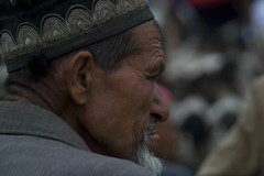 Market place - Kashgar (Man needs to be told) Tags: china hat beard asia market muslim watching profile oldman suit elder kashgar wiseoldman obseving catlemarket