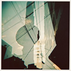 urban soul (Rodrigo Uriartt) Tags: sunset urban 120 film sign analog holga lomo poste doubleexposure portoalegre selection scan wires placa holgagraphy fujipro400h flickrswarmlighting rodrigouriartt spphotofest israelartmetting elzaselection agripas12galery