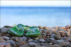 sayonara:  224/365 (helen sotiriadis) Tags: blue sea green beach water canon seaside shoes dof bokeh pebbles depthoffield greece flipflops 365 chios canonef50mmf14usm canoneos40d  vrontades toomanytribbles