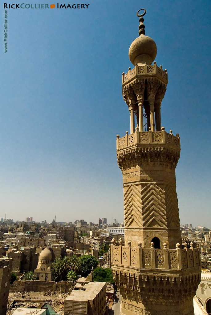 The western minaret of the Bab Zuwayla frames the view toward the more modern city beyond old Islamic Cairo