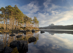 Suilven's reflection in Loch Druim Suardalain. (freeskiing) Tags: trees winter rock clouds scotland highlands december explore lochinver suilven assynt inverpolly canisp highlandsofscotland northwesthighlands glencanisp ndgrad03 benthorburn westhighlandsgeopark lochdruimsuardalain