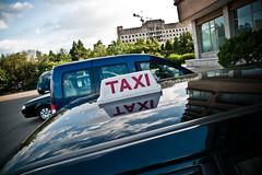 P1000549 (FarewellFire) Tags: taxi communism kimjongil departmentstore northkorea pyongyang dprk juche kimilsung democraticpeoplesrepublicofkorea danielgustafson daesongdepartmentstore