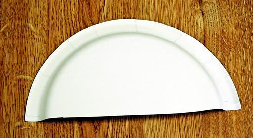 1 Find a paper plate and cut it in half