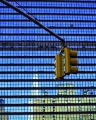 UN-Chrysler reflection under lights (Tattooed JJ) Tags: blue trafficlights yellow photoshop reflections un unitednations aug secretariat jjp cs3 lightroon chryler tattoodjay powershotsd780bayonneparkcanonnjjulypowershotsd780treesbicycingwater