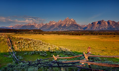 morning at the triangle x ([Adam Baker]) Tags: ranch park morning light summer bird nature clouds canon fence hawk grand dude explore national valley portfolio teton redtailed frontpage mountians jacksonhole sagebrush prarie wy blending 1740l photomatix gtnp trianglex adambake